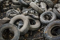 Heap of old car junk tires, used truck rubbish wheels, industrial garbage stock photo