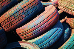 Heap of old colorful worn-out car tires Royalty Free Stock Photos