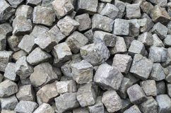 Heap of old granite used paving stones Stock Photos