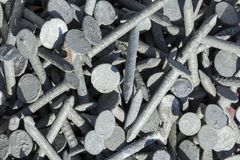 Galvanised steel nails background Royalty Free Stock Photography