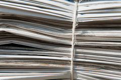Heap of old newspapers bound together Royalty Free Stock Image