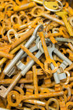 Heap of old rusty keys for sale at the bazaar as background Stock Photography