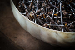 Heap of old rusty nails. Stack of old rusty nails, detail of old workshop Stock Image