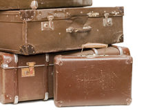 Heap of old suitcases. Isolated on white Stock Photos