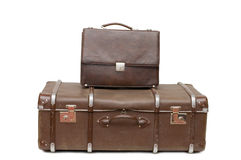 Heap of old suitcases isolated on white. Heap of old suitcases isolated over white Royalty Free Stock Image