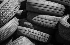 Heap of old used worn-out car tires Royalty Free Stock Image