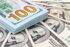 Heap of one hundred american dollar bills Stock Image