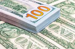 Heap of one hundred banknotes of american dollars Stock Photos