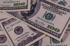 Background of one hundred dollars bills. Heap of the one hundred dollars bills for background Stock Image