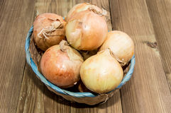 Heap of Onions in a basket Royalty Free Stock Image