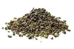 Heap of oolong tea on white background. Close up. High resolution royalty free stock photos