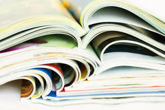 Heap of open magazines Stock Photo