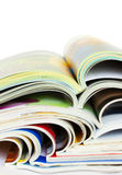 Heap of open magazines Stock Images