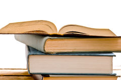 Heap of opened books. Mound of open books on the white background royalty free stock photography