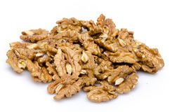 Heap of opened walnuts. Isolated on white Royalty Free Stock Photography