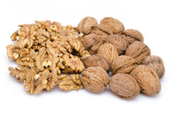 Heap of opened and whole walnuts Royalty Free Stock Photography