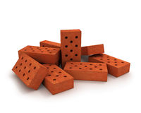 Heap of orange bricks isolated on white Stock Images