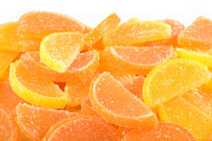 Heap of orange and lemon candy slices on a white Stock Photography