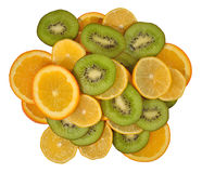 Heap of orange, lemon and kiwi slices on a white Royalty Free Stock Photography