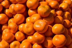 A heap of oranges. Close up shot in direct sunlight stock photo