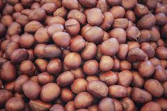 A heap of organic whole roasted chestnuts. royalty free stock photography
