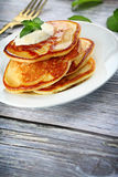 Heap of pancakes. Close up of plate with a pile of home made pancakes Royalty Free Stock Images