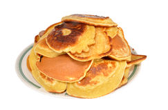 The heap of pancakes lies in a plate. On a table Royalty Free Stock Photography