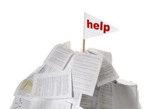 Heap of papers with help flag sticking out Stock Photo
