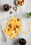 Heap of Paprika Potato Chips. On rustic background Stock Image
