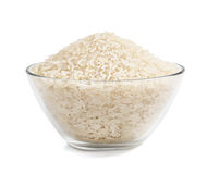 Heap of parboiled rice in glass bowl isolated on white background. Close up, high resolution product. Healthy food Stock Photography