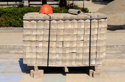Heap of paving stone and helmet Stock Photos