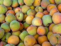Heap of peaches in a market stock photos