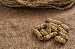 Heap of peanuts on burlap surface background Stock Photos