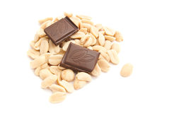 Heap of peanuts and chocolate. Chocolate bar and heap of peanuts on white closeup royalty free stock images
