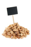 Heap of peanuts  with a pointer for your text Stock Photography