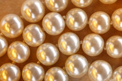 Heap of pearl in warm colour Royalty Free Stock Images