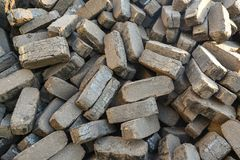 Heap of peat briquettes, alternative fuels royalty free stock images