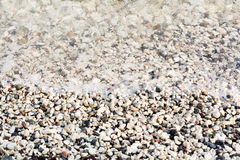 A heap of pebbles under sea water Stock Photo
