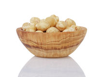 Heap of peeled hazelnuts in bowl isolated Royalty Free Stock Image