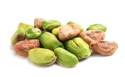 Heap of peeled organic pistachio nuts on white background. Closeup royalty free stock images