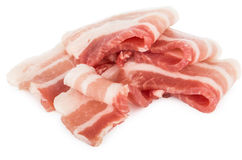 Heap of pieces raw bacon isolated on white Royalty Free Stock Image