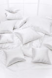 Heap of pillows at a window Stock Image