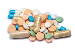 Heap of pills. Colored pills and capsules isolated on white stock photography