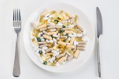 Heap of pills on the dish Royalty Free Stock Photos