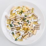 Heap of pills on the dish Royalty Free Stock Image