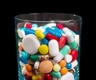 Heap of pills in glass Royalty Free Stock Images