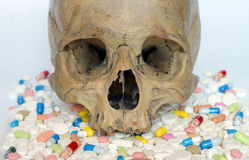 Heap of pills and skull. Stock Images