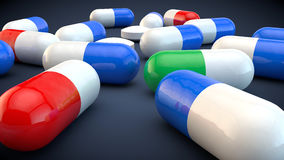 Heap of Pills. Tablets. Medical background. Close-up of pile of red, blue green capsule antibiotics - medical background. 3d render Royalty Free Stock Photos