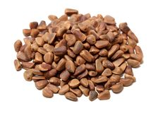 Heap of pine nut close up. On white background stock image