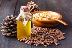 Heap of pine nut and oil on wooden table stock image